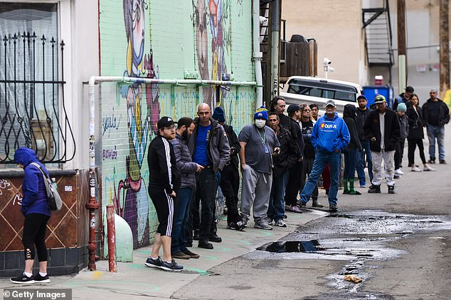 Some locals waited for two hours and stood several feet apart in line at marijuana dispensary Good Chemistry in Denver, Colorado on Monday