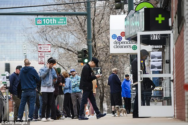 What social distancing? These customers disregarded rules to stand at least six feet apart and crowded outside the marijuana shop High Level Health on Monday