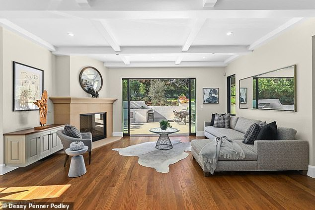 Kicking back: The home contained an array of chic and rugged touches, including a deep-hued hardwood floor