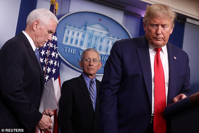 Dr. Tony Fauci (center) resumed attending White House coronavirus briefings with President Trump (right) and Vice President Mike Pence (left) on Tuesday, after being absent for two days