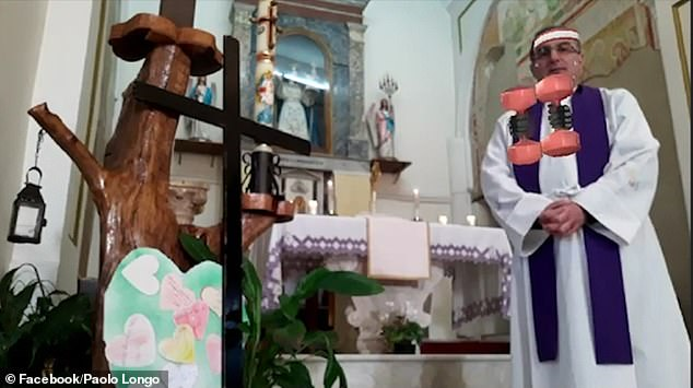 In the hilarious clip, Mr Longo - whose location in Italy is unknown - stands beside a cross and alter dressed in robes as a pair of digital weights suddenly appear