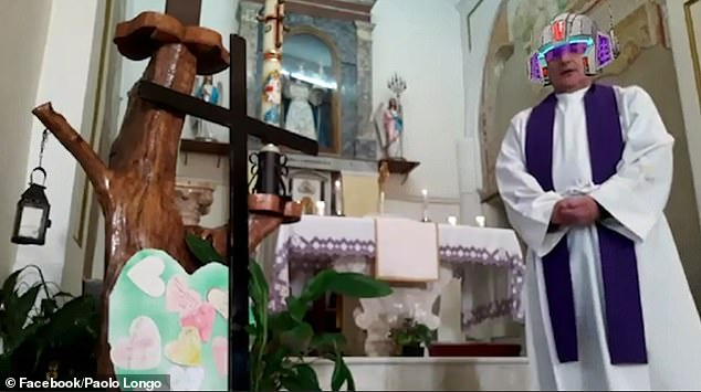 The video, which has been viewed more than three million times on Twitter, captures Italian priest Paolo Longo as he steps back from the camera to begin an online service