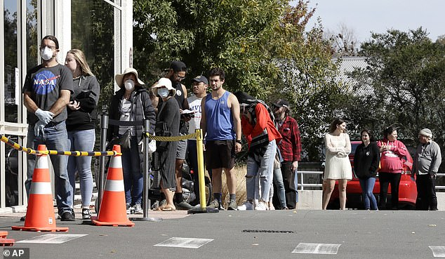 New Zealand will enter a nationwide lockdown beginning at midnight on Wednesday. Pictured:Customers queue to enter a supermarket in Christchurch today