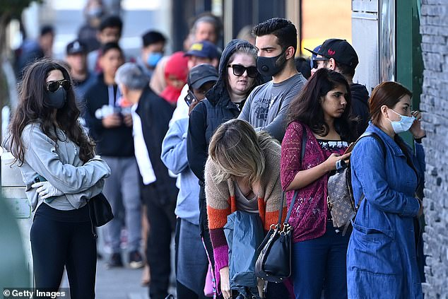 Thousands of hospitality workers were out of work from Monday when the prime minister announced the new measures (pictured: People lining up outside Centrelink this week)
