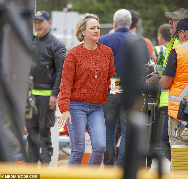 Tense: Meanwhile Shelley appeared concerned as she walked around the site with a coffee cup in hand and a deep frown on her face