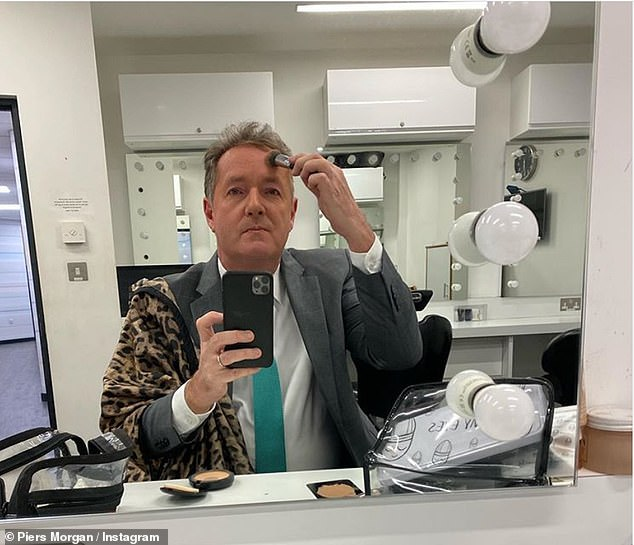 A jack of all trades: Piers Morgan was forced to apply his own make-up for his GMB appearance on Wednesday, to observe social distancing measures amid the COVID:19 pandemic