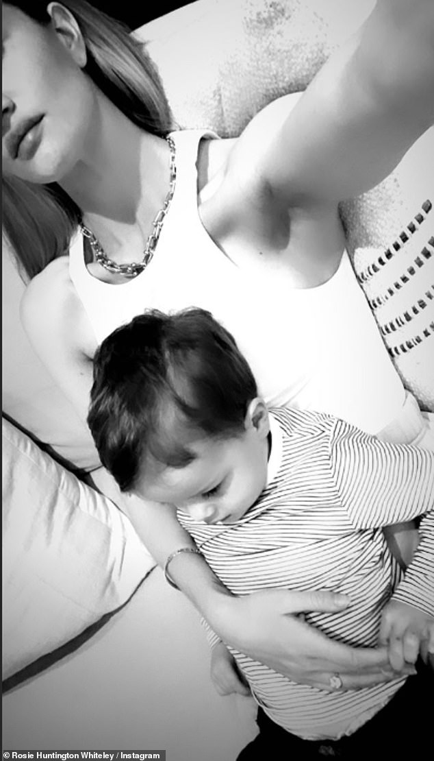 Family portrait:The doting mum also posted a black and white selfie of Jack sitting on her lap as they relaxed at their family home