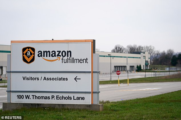 Workers at warehouses in New York, Kentucky (pictured on Tuesday), Florida, Texas, Michigan, Connecticut and Oklahoma have reportedly tested positive for the virus