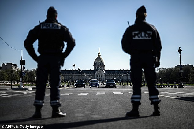 Parisian police officers patrol the streets of Paris to enforce the lockdown in place throughout the country