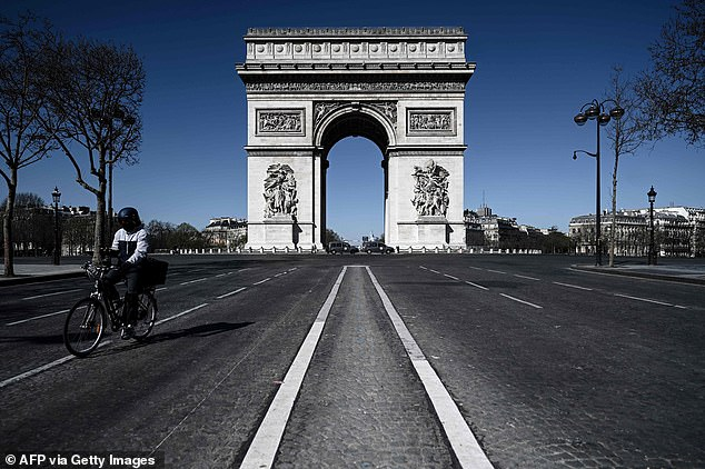 Clear sky and empty roads: The Arc de Triumph in Paris and the roundabout it's on is usually one of the busiest roads in the city