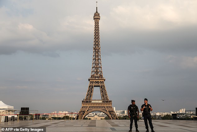 Pictured in 2018, the Paris skies behind the Eiffel Tower are often smoggy. The iconic tower was closed on 13 March due to the spread of COVID-19