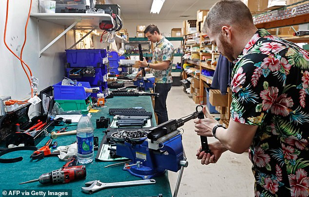 Workers assemble AR-15 rifles at Delta Team Tactical in Orem, Utah