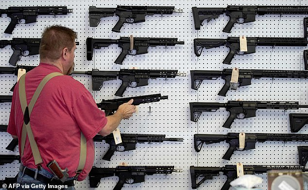 Buyers are snatching up shotguns, handguns, AR-15 (semi-automatic rifles), everything,' says one gun shop owner, describing the kinds of weapons she's sold since the uptick.A worker restocks AR-15 guns at Davidson Defense in Orem, Utah