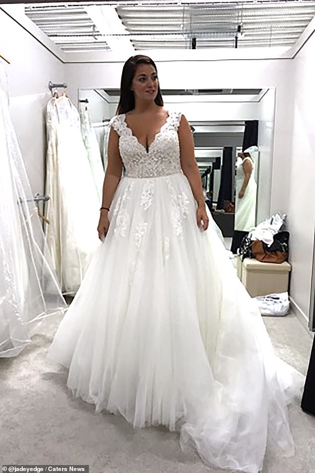 Jade Edgington, 30, from Birmingham, was dumped by her partner by text just months before her wedding day and has become a single mother thanks to a sperm donor (pictured, trying on her wedding dresss)