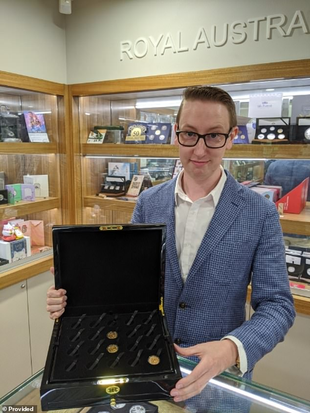 Numismatist Matthew Thompson (pictured) of Downies Coins and Collectables in Melbourne with a display case that is normally full of gold coins. Demand is surging from investors who want to put their wealth into tangible assets to protect against a falling Australian dollar
