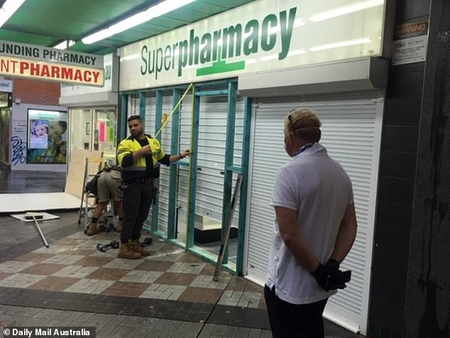 A chemist is being boarded up in an area of Sydney with some of the state's highest coronavirus infection rates. A wall was under construction on Wednesday afternoon at the front of the Superpharmacy at Hornsby, in the city's north, where a wide doorway used to be