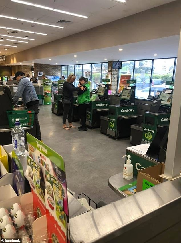 A picture of a Woolworths employee breaking down in tears has offered a heartbreaking insight into the impact panic-buying is having on supermarket workers amid coronavirus