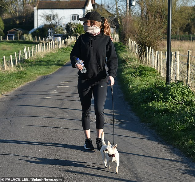 Keeping fit:Summer teamed her casual ensemble with black trainers and shielded her eyes with a black sports cap
