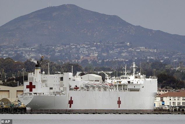 Floating U.S. Navy hospitals are also en route to New York and Los Angeles. The USNS Mercy, a Navy hospital ship, is seen moored at the San Diego Naval Base