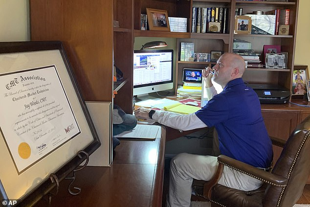 Jay Woods, a US designated market maker with IMC and New York Stock Exchange floor governor, works yesterday in his home office in Basking Ridge, New Jersey