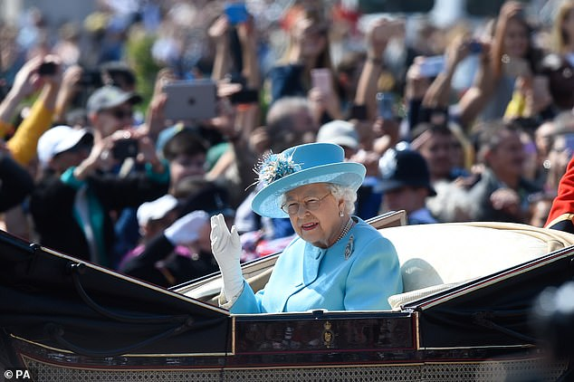 The Queen waves from The Mall before the Trooping the Colour ceremony on June 9 last year