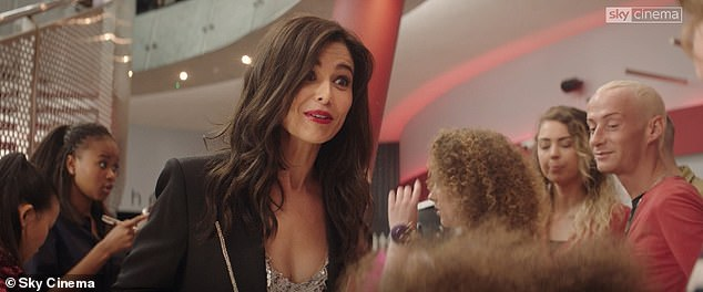 Cameo: scene exchange for screen, Cheryl is first seen wearing a black sequined blazer, while welcoming the family of Smash (Ashley Aufderheide) in the 02 arena before her great performance