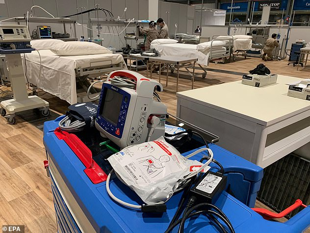 Spain has registered a new record number of coronavirus deaths in a single-day period. Pictured: Field hospital in Madrid