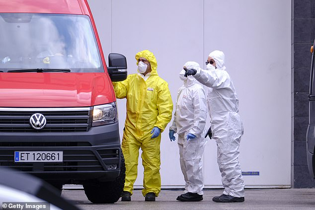 The sharp increase in the number of deaths caused by coronavirus has laid to bodies being left longer than normal. Pictured:Members of the Emergency Military Unit