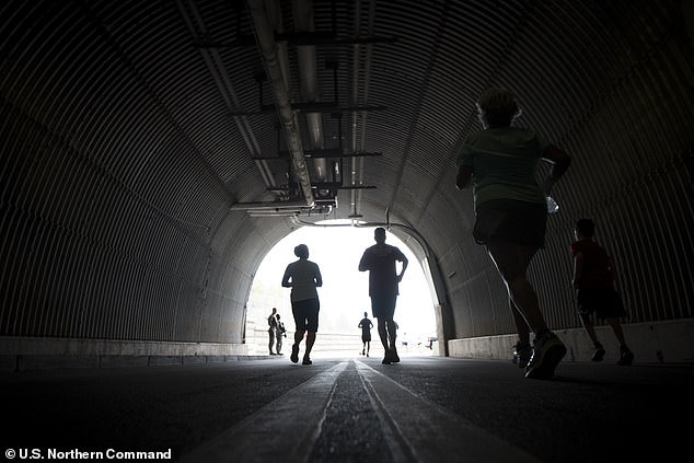 Army personnel are pictured running through the tunnel at the Cheyenne Mountain Complex