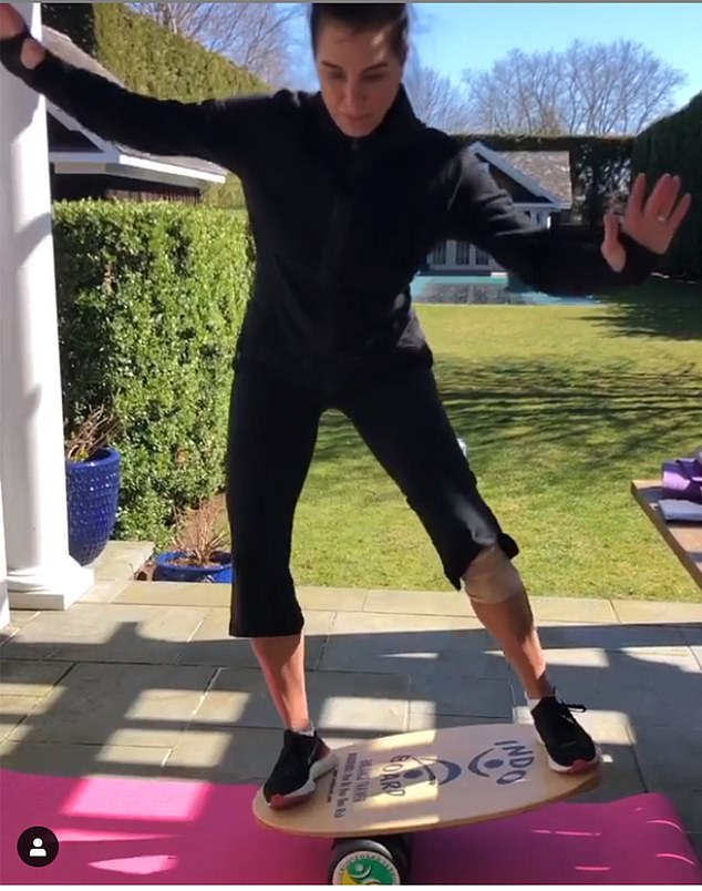 A BALANCED LIFESTYLE: Actress Brooke Shields grapples with some tricky exercises in her sunny garden