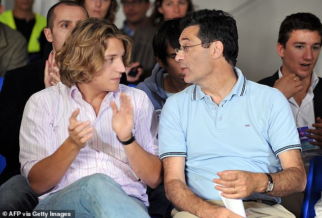 Patrick Devedjian (pictured right) speaks with the son of then French President Nicolas Sarkozy, Jean Sarkozy during a political meeting in Royan