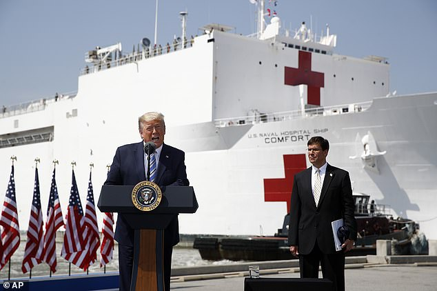 Trump speaks in front of the US Navy hospital ship USNS Comfort at Naval Station Norfolk in Norfolk, Virginia, Saturday. He said he is considering quarantining New York and parts of Connecticut and New Jersey in a desperate effort to slow the spread of coronavirus