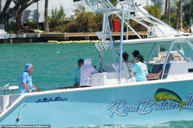 These Floridians enjoy a gathering aboard a boat despite recommendations by the government to avoid people during the coronavirus pandemic