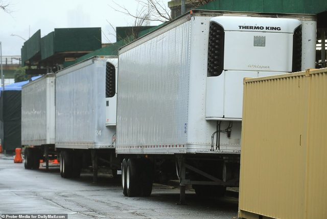 Each refrigerated truck is said to be able to hold some 44 bodies. The above makeshift morgues are seen outside NYU Langone Hospital