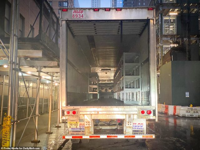 An empty refrigeration truck is seen above outsideMount Sinai West at 59th St and Amsterdam Avenue in Manhattan on Sunday