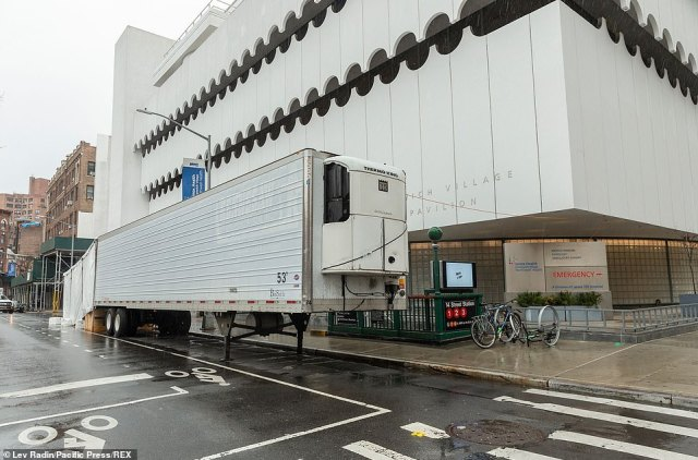 The above image shows a makeshift morgue trailer set next to Lenox Health Medical Pavilion, which part of Northwell Health system, in Greenwich Village in Manhattan