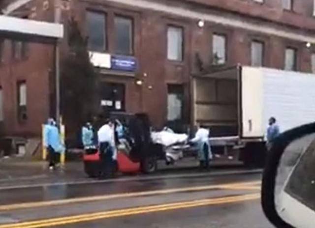 Dramatic video from Sunday shows hospital workers using a forklift to load a body into a makeshift morgue outside the Brooklyn Hospital Center in Fort Greene, Brooklyn, on Sunday