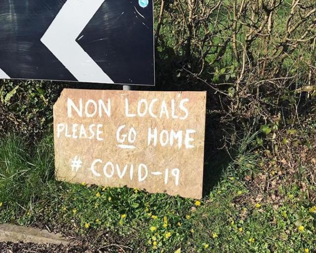 A sign erected near Pembrokeshire reads 'non locals please go home #covid-19'