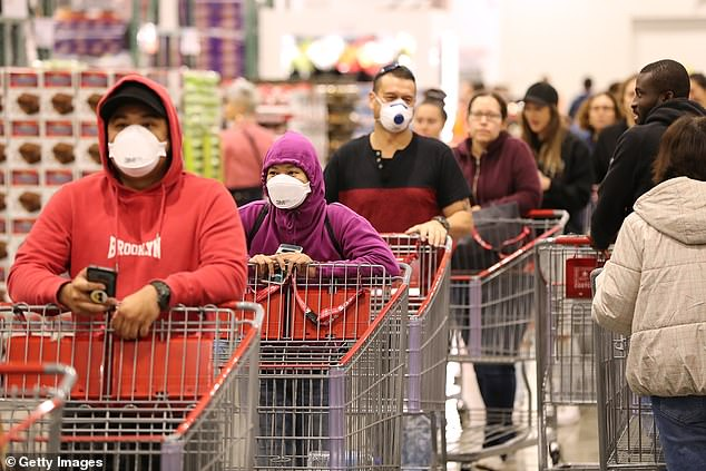 Shoppers line the aisles at Costco Perth on March 19, 2020 in Australia, as wholesaler limits toilet paper sales to one per customer in response to COVID-19 panic buying