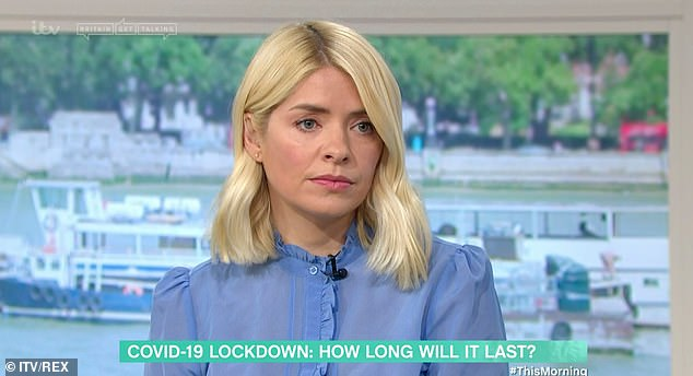 Unsure: Holly Willoughby revealed on This Morning on Monday she is either 'euphorically happy or desperately sad and is craving middle ground' amid COVID: 19 lockdown