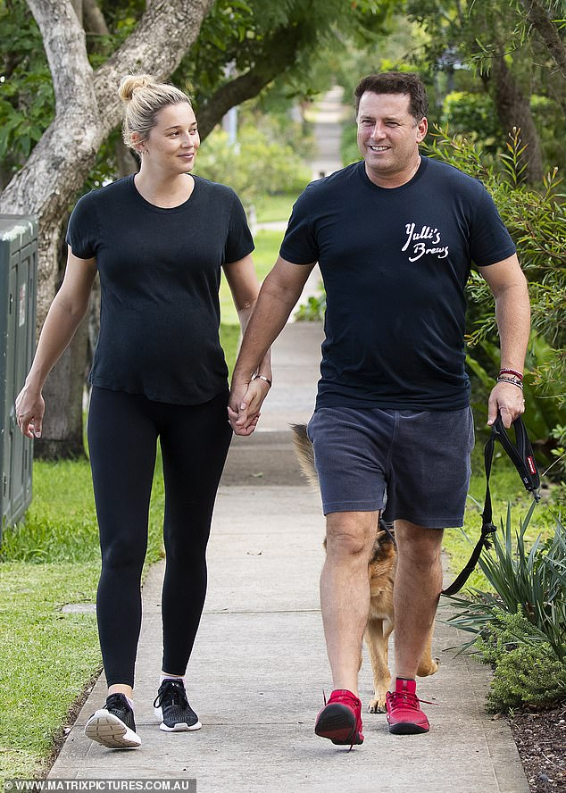 Loved-up: The Today show host, 45, smiled as he strolled hand-in-hand with his 36-year-old partner down a leafy street, while the couple gave their dog Chance The Yapper some exercise