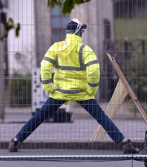 Pictured: A worker at the testing site in Chessington