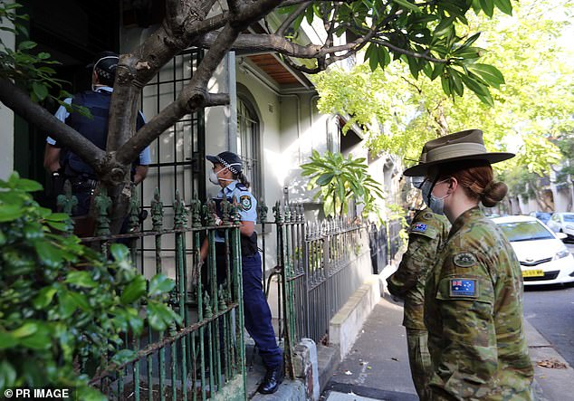 The officers were seen conducting Public Health Order checks at homes and businesses across Sydney