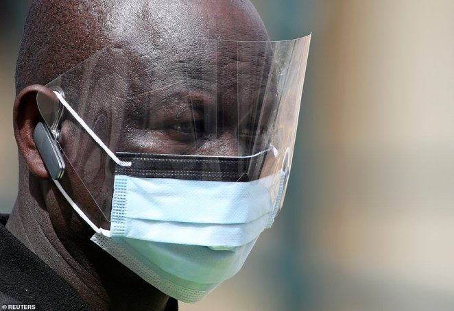 A security guard wearing protective face mask is seen at a pop-up clinic testing for the coronavirus disease