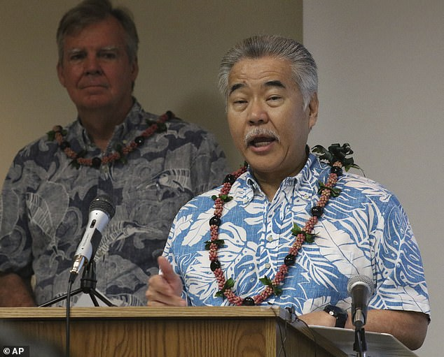 Hawaii Governor David Ige, pictured with State Health Department Director Bruce Anderson, stressed the importance of staying at home following that state's first coronavirus death
