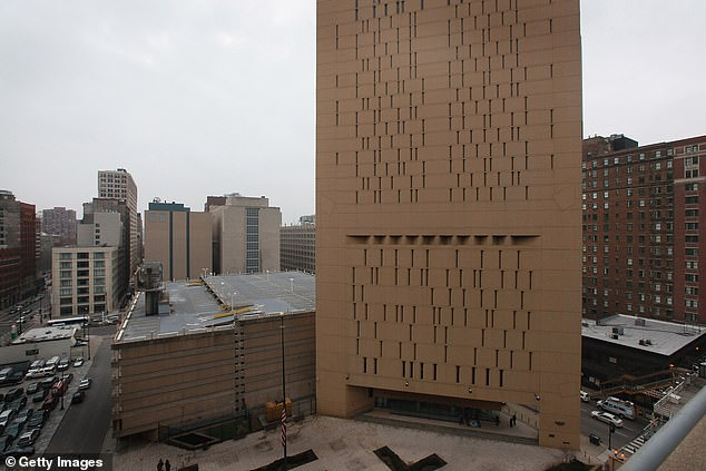 Pictured: The federal Metropolitan Correctional Center is pictured on December 18, 2012 in Chicago, Illinois. The confinement of prisoners across the US comes a day after a man died from COVID-19 at a facility in Louisiana