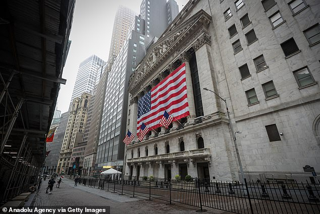 The New York Stock Exchange is seen quiet earlier this week. Stocks were set to drop after Trump warned the next two weeks would be 'very, very painful'