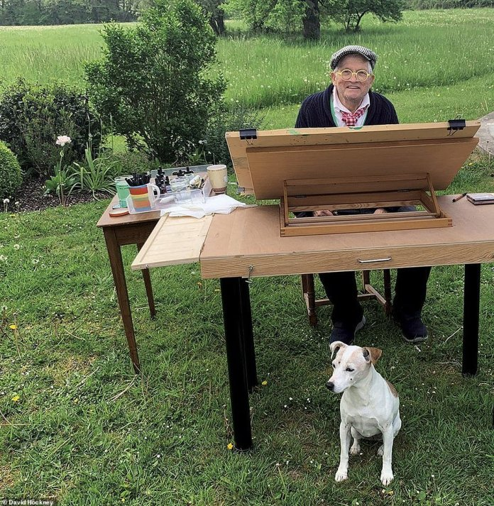 David Hockney, a celebrated British artist, pictured with his dog Ruby while sat outside in his garden in Normandy, northern France, where he plans to spend every day of the season painting. He has unveiled 10 new images created on his iPad during isolation at his home, including one animation, in an attempt to bolster the nation's spirits amid the coronavirus crisis