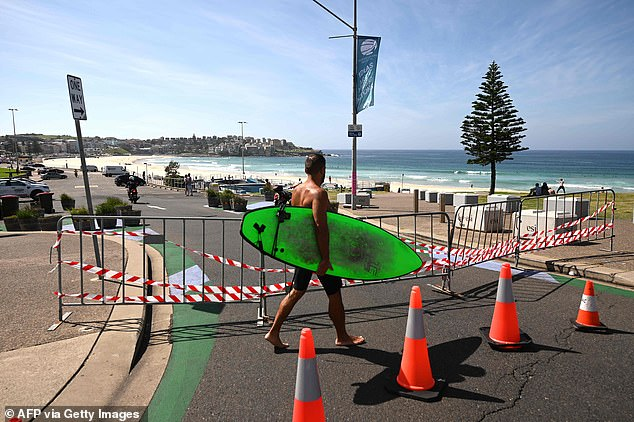 Surfing is still allowed in most states however in some cases where local councils have shut the beach, such as Bondi (above), catching a wave is outlawed