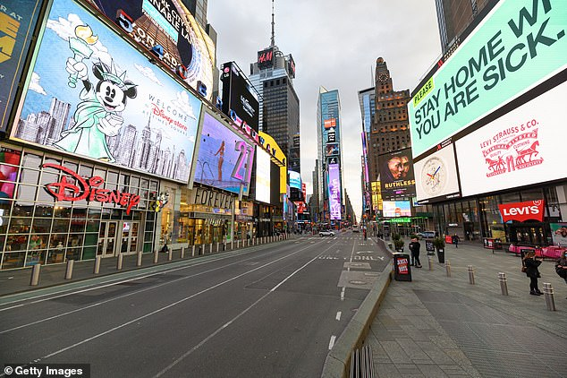 Manhattan is currently under lockdown to slow the spread of the coronavirus. Here, Times Square can be seen almost totally empty as people remain inside and practice social distancing